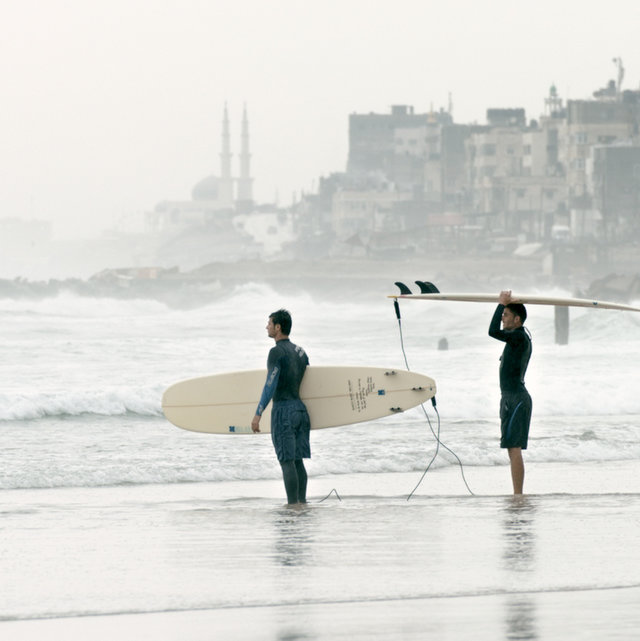 Surfers on the beach in Gaza; a scene from the powerful documentary about Israel, Egypt, and the Gaza Strip